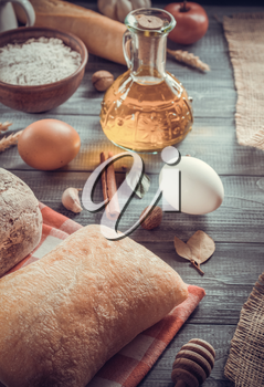 bread and bakery products on wooden background