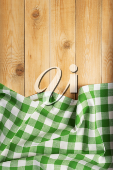 cloth napkin at rustic wooden plank board table background, top view