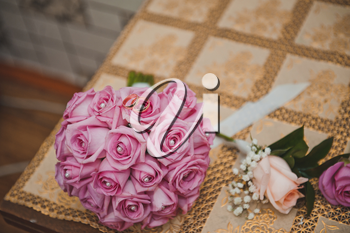 The bouquet and rings lie on a table.