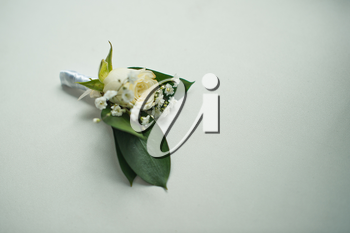Beautiful buttonhole from a rose and white florets.