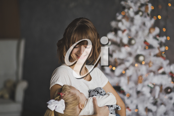 Christmas portrait of mother and daughter.