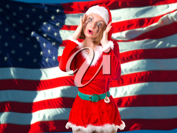 Girl dressed as Santa Claus on a background of the American flag