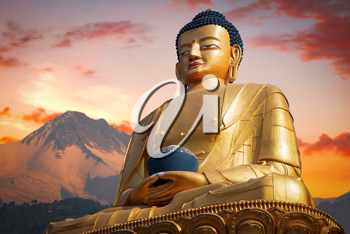 Golden Buddha in Kathmandu on a background of the Himalayas mountains