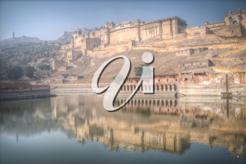 Amber Fort or Amer - fortified residence of Raja in the eponymous northern suburbs of Jaipur, on the crest of a rocky hill behind the lake Maota