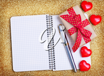 red hearts and note book on a table