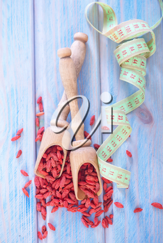 dry goji berries on the wooden table