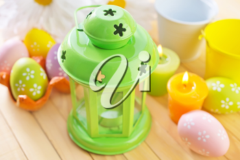 candle and easter eggs