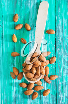 almond in spoon and on a table