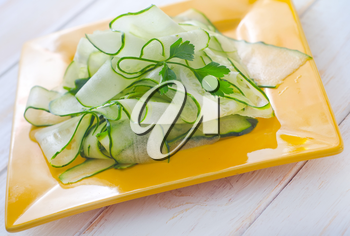 Fresh salad with fresh cucumber and parsley