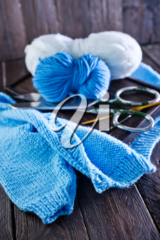 knitting on a table, blue threads for knitting