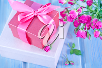 boxes for presents and floers on a table