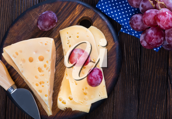 cheese with grape on the wooden table