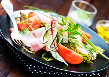 fresh salad on plate and on a table