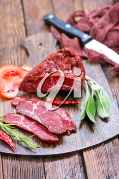 smoked meat with spice on wooden  board