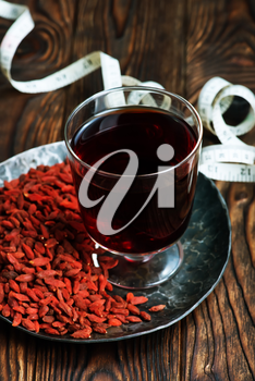 drink from goji and dry goji on a table