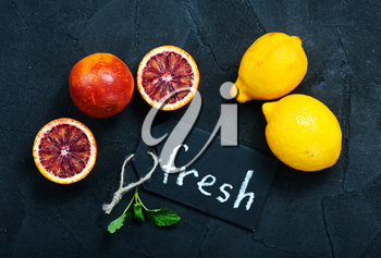 citrus background, fresh citrus fruit on a table