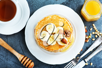 pancakes with honey and nuts on the plate