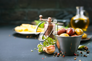 olives with spice in metal bowl and on a table