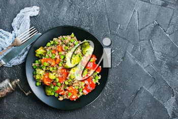 Quinoa salad with pepper, avocado , broccoli and oil . Vegan superfood