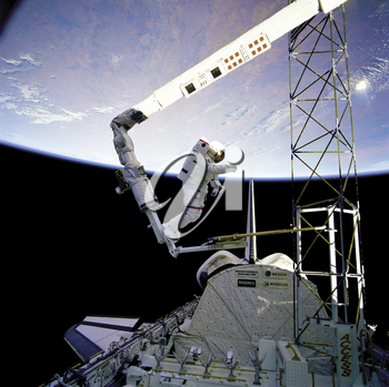 Royalty Free Photo of Astronaut Bruce McCandels working on the STS-41-B
