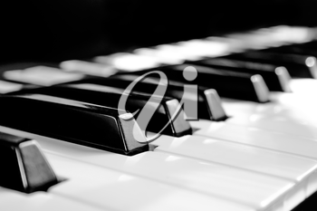 Black and white keys with reflection, shifting the focus and stylized old photo