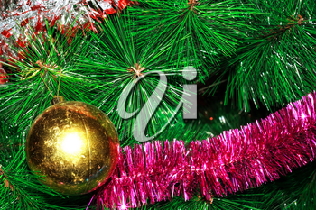 Shabby ball and tinsel on artificial Christmas tree