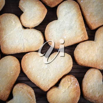 Close-up of heart shaped cookies. Cookie hearts background. Top view.