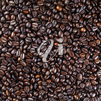Brown coffee beans background. Coffee beans texture. Top view