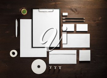 Branding mock up. Photo of blank corporate stationery on wooden background. Flat lay.