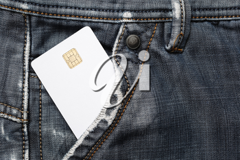 Blank white plastic chip card in jeans pocket. White credit card.