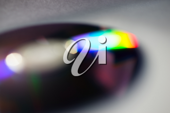Horizontal cd disc with color reflection bokeh background