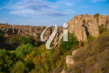 Deep granite canyon with the Mertvovod river in Aktovo village, Nikolaev region, Ukraine, on a sunny evening. One of the natural wonders of Ukraine