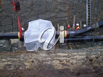 Sakhalin, Russia - 12 November 2014: Laying of the gas pipeline in a ditch. Installation works.