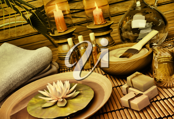 The still life Spa with aromatic oil, candles, a lotus flower, blue clay, soap and towels.
