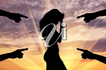 Concept of deceit and betrayal. Silhouette of a woman and condemning the hands of people at sunset