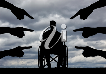 A disabled person in a wheelchair, people hands showing a finger at him. The concept of discrimination against people with disabilities