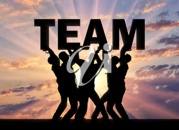 Silhouette of a group of men who hold the word team above themselves. The concept of a business team and teamwork