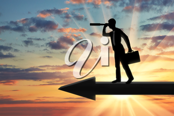 A silhouette of a businessman looking through a telescope into the distance while standing on the arrow. Search ideas and opportunities in the business concept