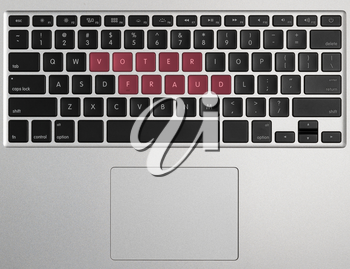 Laptop or PC computer keyboard with letter spelling Voter Fraud highlighted in red illustrating potential vote errors with illegal votes and need for recount