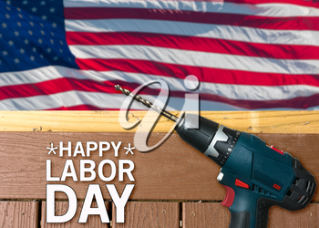 Drill on composite deck in front of USA flag for Labor Day background poster