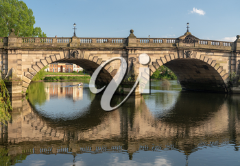 View of river Severn and English Bridge in Shrewsbury Shropshire with Eight rowing boat in background