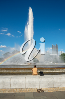 Tourist soaks his feet in the fountain at Point State Park in Pittsburgh PA