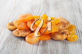 Dried fruits on a wooden background. Candied fruits, lemon, apricot, figs.