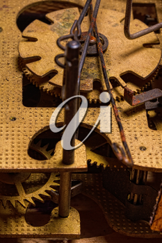 Close-up of an old dirty rusty brass clockwork with cuckoo clock gears