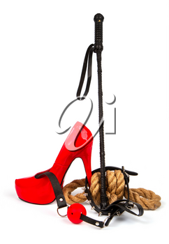 Accessories for BDSM collar with spikes, gag, red shoes and leather stack on a white background