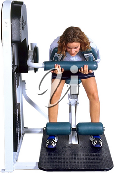 Royalty Free Photo of a Woman on Weight Lifting Machine