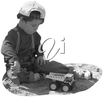 Royalty Free Photo of a Child Playing in the Sand