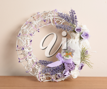 Interior decoration, wicker wreath with lavender and ribbon.
