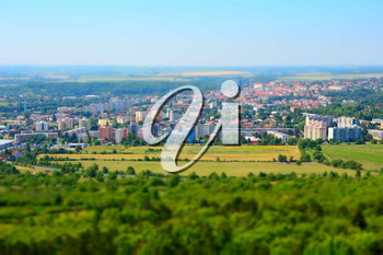 Tilt shift landscape panorama of the Kutna Hora city and forest in the Czech Republic.