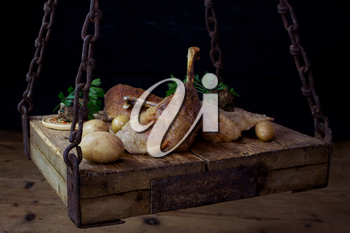 Roasted Goose Meat Served With Potatoes, Stuffing and Fresh Parsley On a Wooden Surface